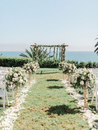 wedding-ceremony-grass-lawn-pink-white-flowers-wood-arbor-greenery-pink-flowers