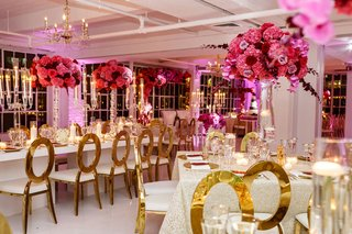 wedding-reception-all-white-ballroom-with-candles-candelabra-pink-fuchsia-flower-centerpieces