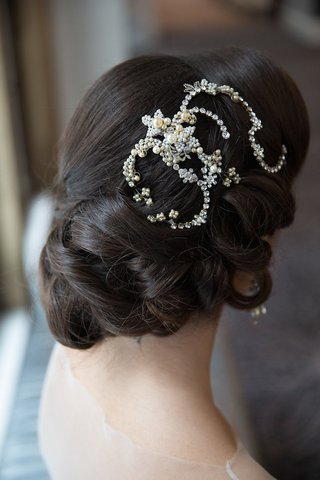 bride-with-updo-wedding-hairstyle-and-swirl-headpiece-with-crystals-and-pearls