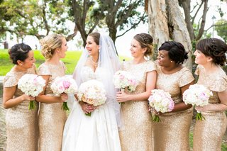 bride-in-allure-ball-gown-bridesmaids-in-gold-sequin-sorella-vita-gowns