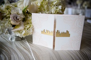 wedding-invitation-booklet-with-gold-skyline-cutout-houston-texas-pink-floral-motif-on-folds