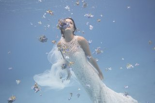 bhldn-high-neck-wedding-dress-in-ocean-with-flowers