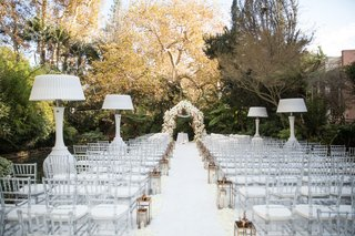 wedding-ceremony-outdoors-in-january-hotel-bel-air-white-aisle-chairs-lanterns-heat-lamps-flowers