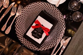 wedding-reception-black-table-charger-plate-black-napkin-red-ribbon-black-thank-you-note