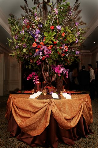 large-arrangement-with-greenery-peacock-feathers-and-pink-orange-purple-and-red-flowers