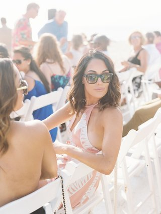wedding-guest-dress-ideas-pink-halter-sunglasses-wedding-outdoor-malibu-cj-perry-lana-brie-bella