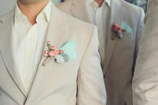 groomsmen-wear-pink-rosebud-and-dusty-miller-boutonnieres-and-light-green-pocket-squares
