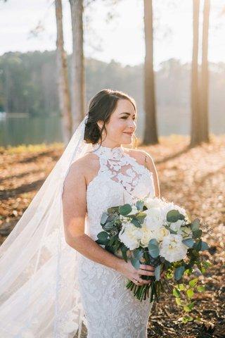 bride-portrait-white-lace-mock-turtleneck-wedding-dress-lace-cathedral-veil-hair-up-winter-wedding