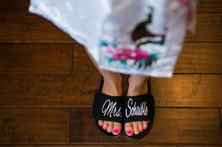 bride-bright-pink-pedicure-wearing-black-white-bath-slippers-mrs-schaible-married-name
