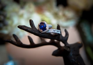 blue-jewel-stone-with-halo-diamonds-and-eternity-band