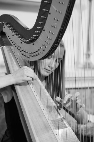 black-and-white-photo-of-woman-playing-harp