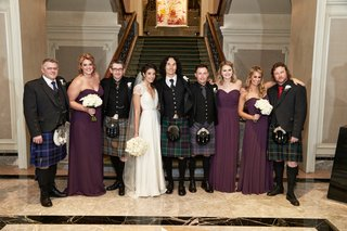 bride-in-a-jenny-packham-dress-bridesmaids-in-purple-dresses-groom-groomsmen-in-kilts-blazers