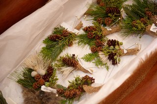 christmas-tree-and-pinecone-boutonnieres-wrapped-with-burlap