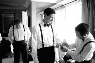 black-and-white-photo-of-men-getting-ready-before-wedding