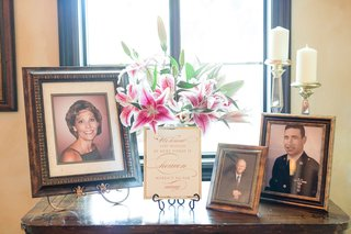 wedding-cocktail-hour-reception-table-with-photos-of-late-loved-ones-deceased-with-sign-and-lilies