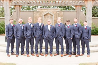 groom-and-groomsmen-in-navy-suits-brown-dress-shoes-pink-flower-boutonnieres