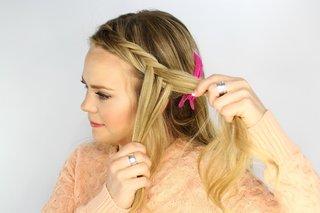 bride-braiding-hair-into-fishtail-braid-for-wedding-day-hairstyle