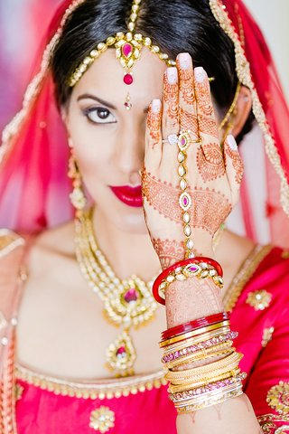 halo-engagement-ring-and-indian-wedding-bangles-in-gold-and-red