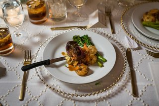 wedding-reception-meal-filet-with-garlic-butter-shrimp-potato-hash-broccolini