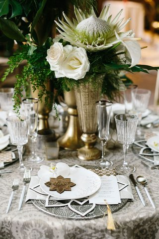 tropical-wedding-centerpiece-moroccan-style-theme-lotus-white-rose-large-protea-white-anthurium