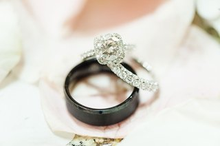 bride-round-diamond-square-halo-engagement-ring-with-eternity-band-and-mens-black-manly-bands-ring