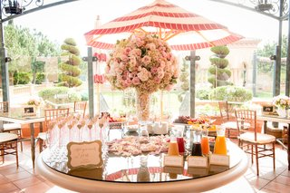 wedding-shower-table-with-mimosa-bar-fresh-fruit-centerpiece-of-pink-roses-green-hydrangeas