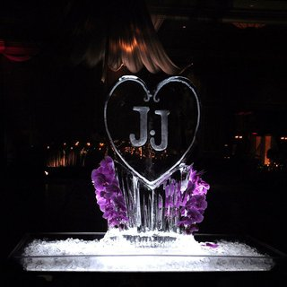 purple-orchids-decorating-monogrammed-ice