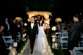 bride-and-groom-recessional-at-outdoor-evening-wedding