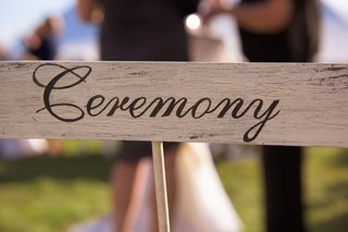 wood-ceremony-sign-at-rustic-outdoor-wedding-on-marthas-vineyard