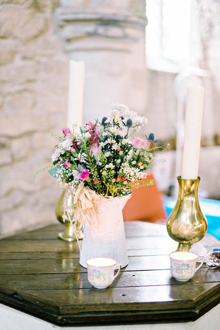 small-wildflower-floral-arrangement-church-ceremony-tea-cups-watering-can-garden-motif-british