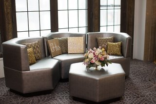 wedding-lounge-with-contemporary-sofas-octagon-table-gold-patterned-throw-pillows