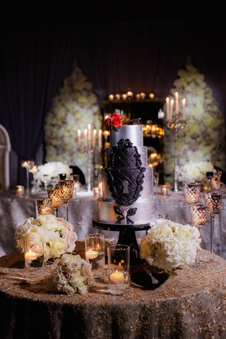 wedding-cake-in-silver-with-black-tufted-details-keyhole-antique-key-embellishments-red-rose