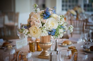 gold-vase-with-white-pink-and-blue-flowers