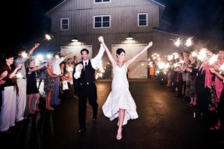 bride-and-groom-pass-through-wedding-guests