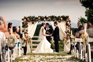 bride-and-groom-at-alfresco-wedding-ceremony