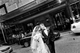 black-and-white-photo-of-bride-and-groom-in-chicago-smiling-and-touching-foreheads