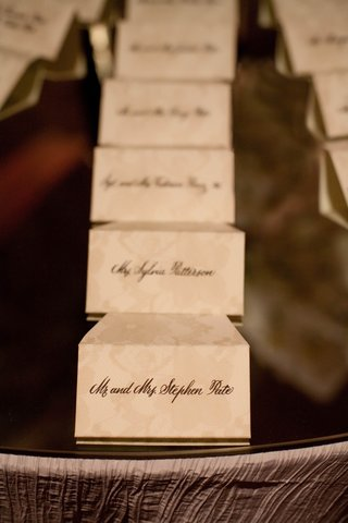 ivory-seating-cards-with-tan-flower-motif
