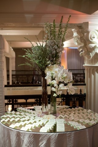 table-with-mirror-top-and-seating-cards-and-orchid-arrangement