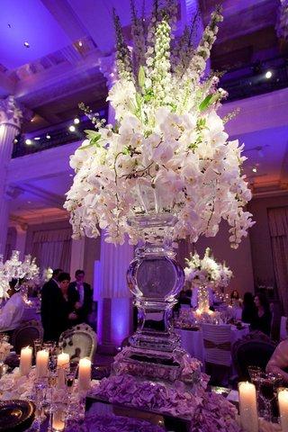 ice-sculpture-vase-with-white-orchid-flower-arrangement