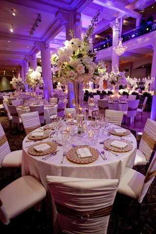 purple-wedding-lighting-with-white-and-gold-table-decorations