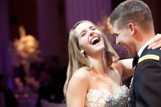bride-and-groom-in-dress-blues-laugh-as-they-dance
