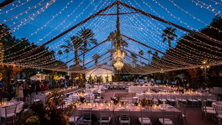 wedding-reception-la-quinta-resort-spa-outdoor-wedding-fairy-lights-in-tent-formation-chandelier