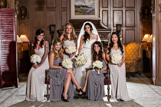 bridesmaids-dressed-in-dark-and-light-gray-long-dresses