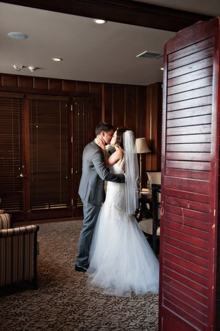 newlyweds-exchange-a-kiss-after-the-ceremony
