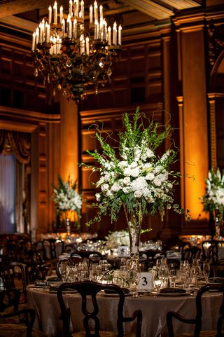 tall-centerpiece-with-white-flowers-and-green-branches