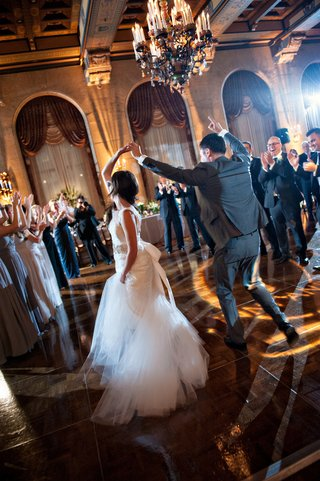 bride-and-groom-dance-surrounded-by-guests