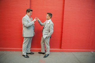 gay-men-outside-in-front-of-red-brick-backdrop