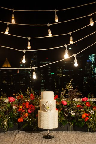 intimate-sized-wedding-cake-on-outdoor-terrace