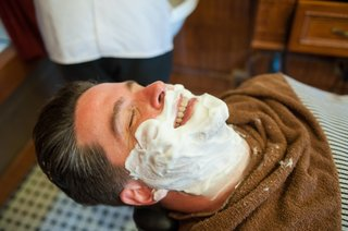groom-with-shaving-cream-on-face-at-barbershop