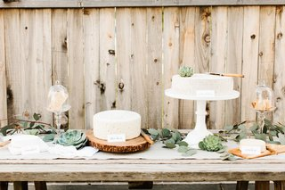 cake-table-with-cheese-wheels-and-rustic-wood-stands